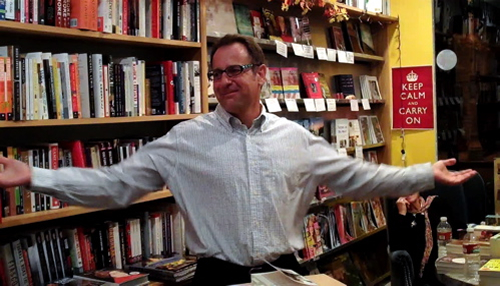 Author with Uplifted Arms
